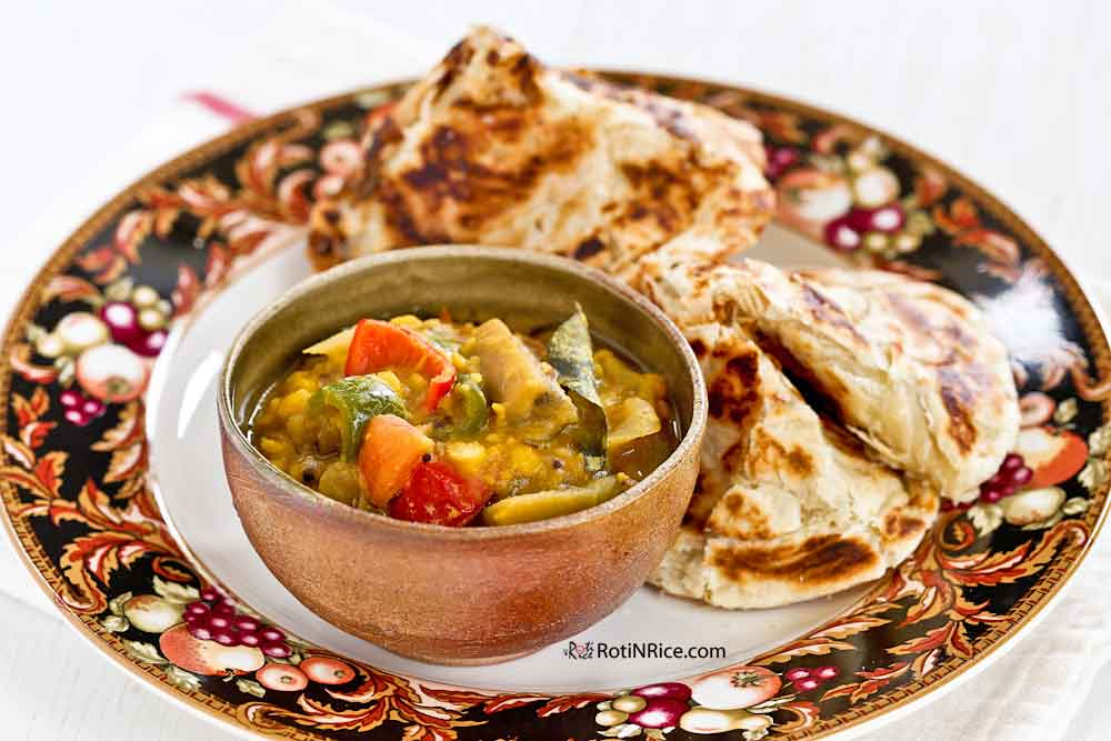 Dhal and Eggplant Curry served with roti canai/pratha