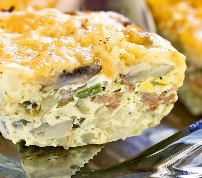 A delicious slice of layered Sausage Hash Brown Egg Bake.