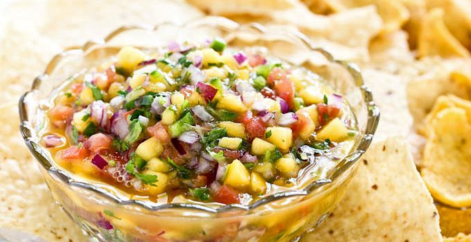 Sweet, tangy, refreshing Mango Peach Salsa. Great with tortilla and corn chips for all your summer parties and get-togethers. | RotiNRice.com