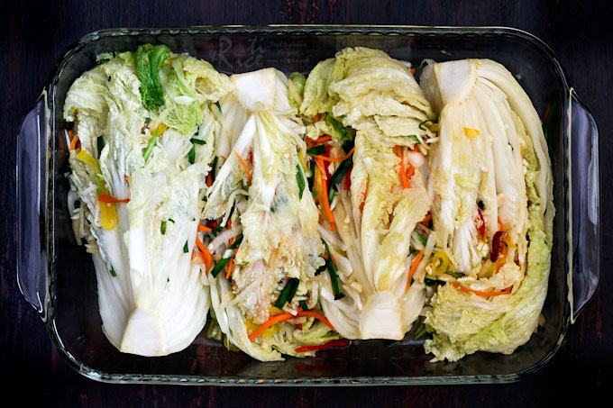 Non spicy cabbage Baek Kimchi (White Kimchi) stuffed with a variety of vegetables, fruits, and nuts. Relatively mild, slightly sweet, and quite refreshing. | RotiNRice.com