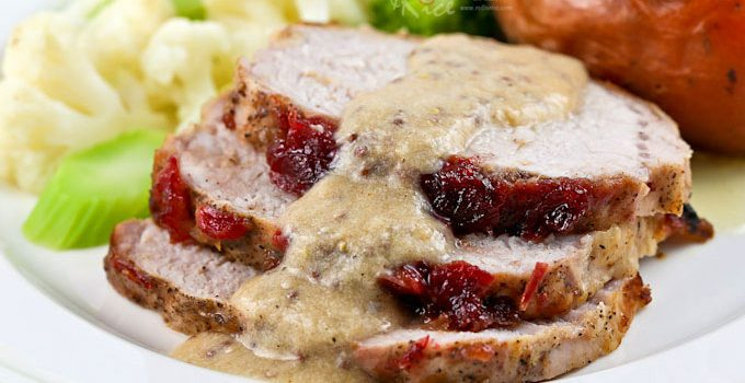 Use leftover cranberry sauce to make this moist, tender Cranberry Sauce Pork Loin Roast with creamy Dijon mustard sauce. Only an hour to prepare. | RotiNRice.com