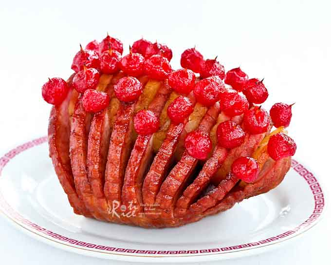 This boneless Hasselback Pineapple Ham is perfect for a smaller family or crowd. Add Maraschino cherries for a festive look.| RotiNRice.com