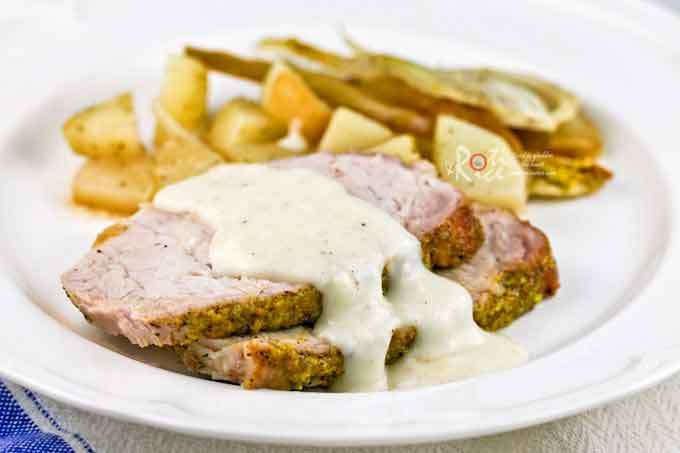 The salty pistachios and creamy horseradish sauce give this Pistachio Crust Pork Loin Roast great flavor. Easy to prepare and feeds a crowd. | RotiNRice.com