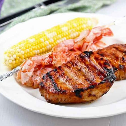 These Grilled Pork Chops are tender, juicy, and full of flavor. Minimum preparation time and cooks in 10 minutes on the grill. | RotiNRice.com