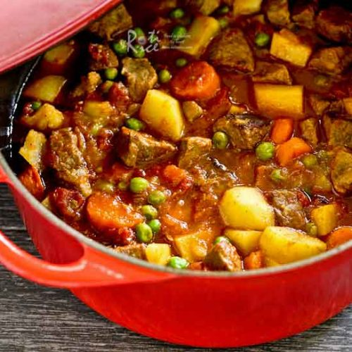 This deliciously Hearty Beef Stew with tender cubes of meat, potatoes, carrot, and green peas is comfort food for the soul. Perfect any time of the year. | RotiNRice.com