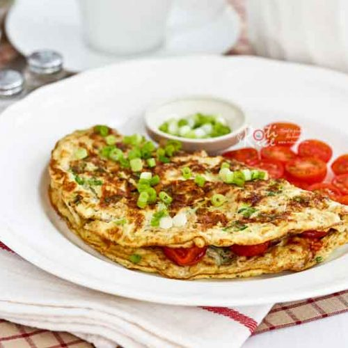 Start your day right with this low calorie, energy packed Tomato Oatmeal Omelet. It is tasty, fulfilling, and very easy to prepare. | RotiNRice.com