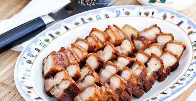 Make this quick and easy Pan Fried Crispy Pork Belly in 40 minutes. Only 4 ingredients and just as tasty as the oven roasted version. | RotiNRice.com #crispyporkbelly #porkbelly #siuyuk #siewyoke
