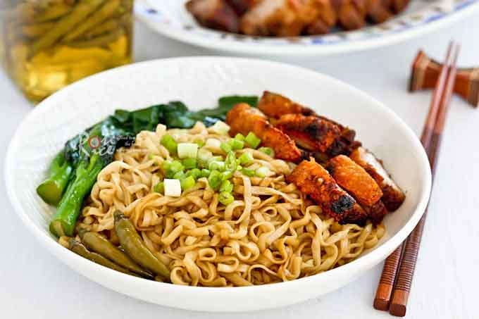 Crispy Pork Belly served with dry style tossed noodles.