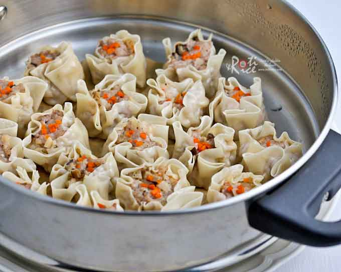 Siu Mai (Shumai) are tasty open-faced dumplings filled with ground pork, shrimps, and other add-ins. They are one of the most popular dimsum offering that can be easily made at home. | RotiNRice.com