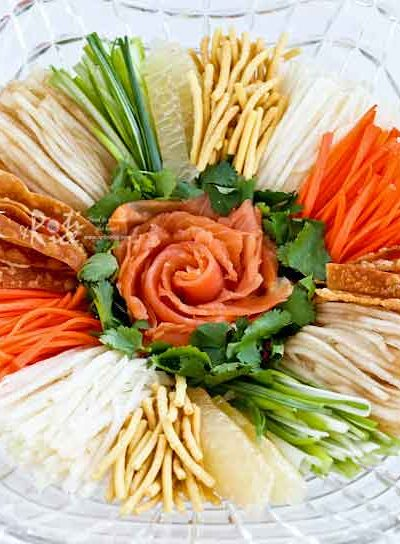 Prosperity Toss Salad (Yee Sang/Yusheng) is a great starter for your Chinese New Year feast. It is a tasty, and fun dish to share with family and friends. | RotiNRice.com #prosperitytosssalad #yeesang #yusheng #chinesenewyear #lunarnewyear