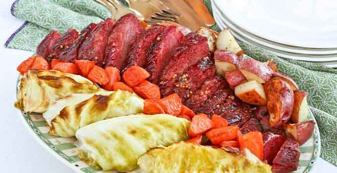 This Guinness Brown Sugar Glazed Corned Beef is a must-try. The sweet malty glaze gives this roasted corned beef its distinctive flavor and appearance. | RotiNrice.com #cornedbeef #cornedbeefandcabbage #guinnessstout #guinness #StPatricksDay