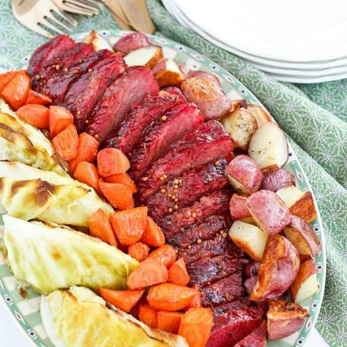 Corned Beef served with roasted potatoes, carrots, and cabbage.