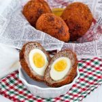 Scotch Eggs are hard boiled eggs wrapped in flavorful sausage meat and deep fried. Easy to prepare and very yummy. A must-try! | RotiNRice.com