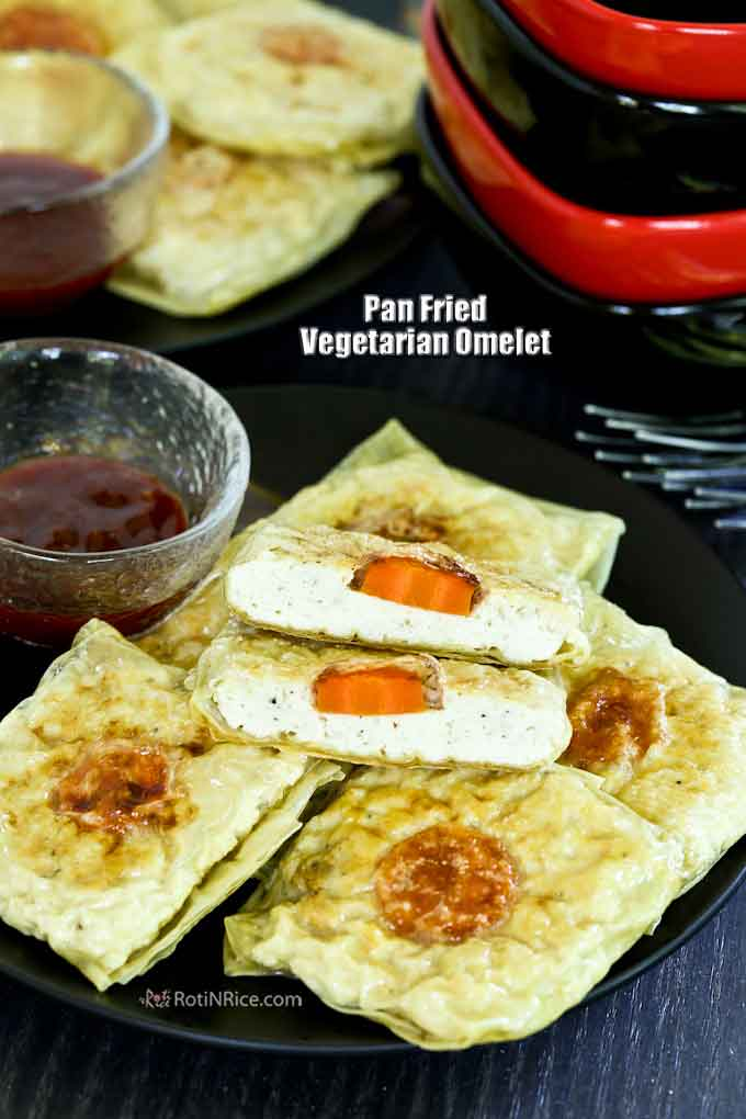 Vegan omelet served with sweet chili sauce.
