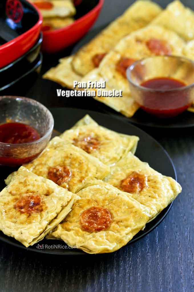 Crispy pan fried vegan omelet served with chili sauce.