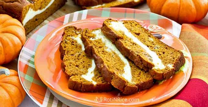 Pumpkin Cream Cheese Swirl Bread - a super moist and delicious bread with a cream cheese filling perfect for fall entertaining or a weekend brunch. | RotiNRice.com