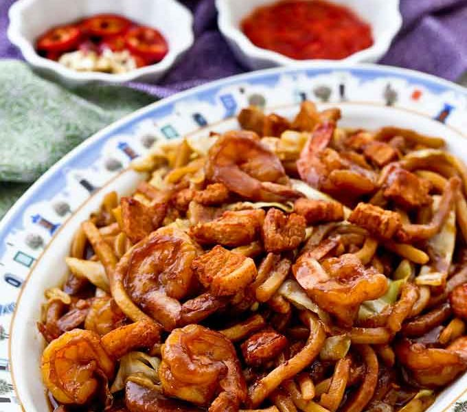 KL Hokkien Mee or Hokkien Char served with sambal belacan and cut red chilies.