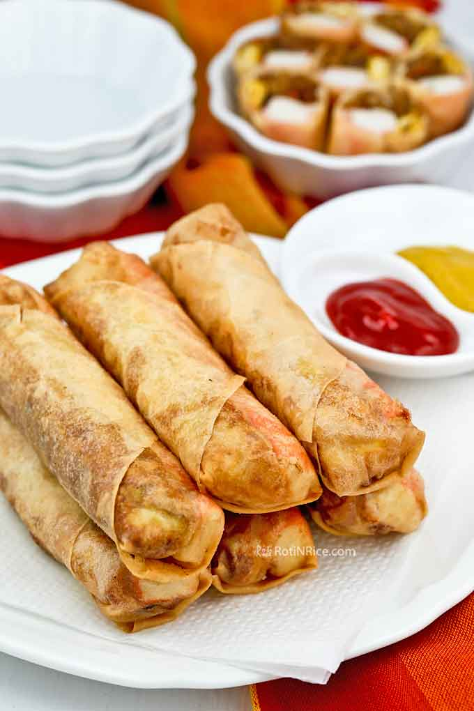 Special Tri-Filling Spring Rolls wrapped with egg omelet, fish sticks, and stir fry jicama. Delicious served with sweet chili sauce and mustard. | RotiNRice.com