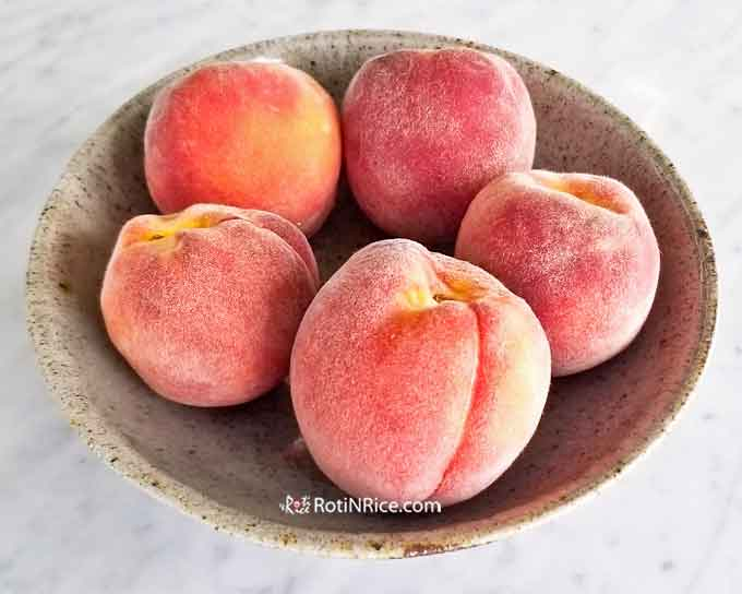 A bowl of sweet ripe peaches from our Pix Zee Miniature Peach Tree.