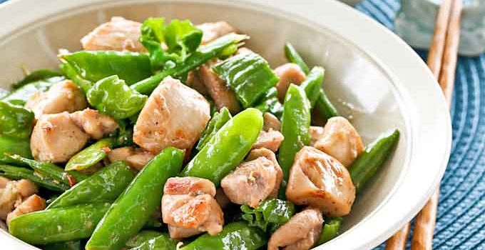 This Chicken Stir Fry with Sugar Snap Peas and Shishito Peppers is perfect for a quick weeknight dinner served with rice. Less than 30 minutes to prepare. | RotiNRice.com #chickenstirfry #stirfryrecipes #chickenrecipes #quickdinnerideas