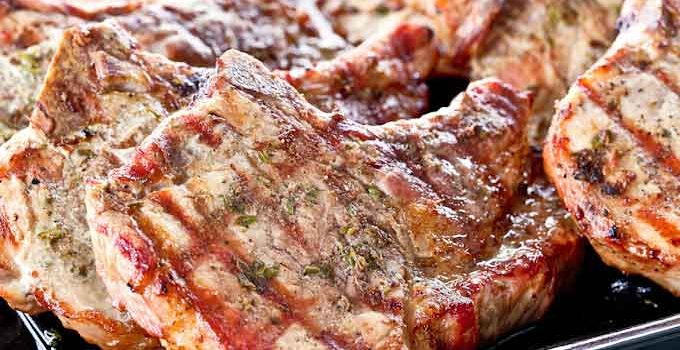 Rosemary Anchovy Pork Chops cooked on the grill to perfect tenderness. They are super moist and flavorful with the rosemary, anchovies, and thyme marinade. | RotiNRice.com #porkchops #grilledpork #grillingrecipes