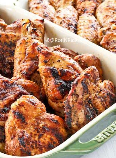 Easy Grilled Bone-In Chicken Thighs and Wingettes with low and slow heat for juicy meat and crispy skin. Lower heat prevents charring. | RotiNRice.com #grilledchicken #grillingrecipes #chickenrecipes