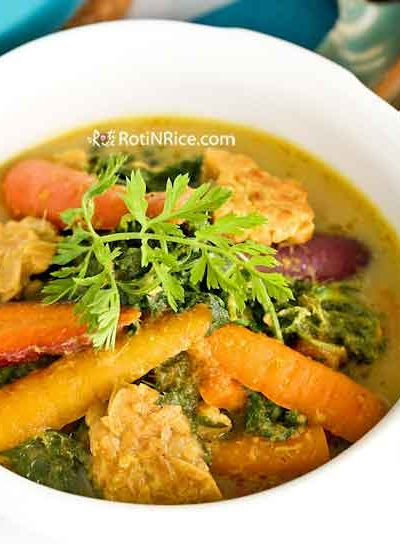 Lobak Lodeh with homegrown multi-colored carrots and their tops simmered in coconut milk. Tempeh provides additional flavor and texture. | RotiNRice.com #sayurlodeh #lodeh #coconutmilk