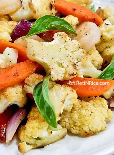 Tender crisp Cauliflower Shrimp Stir Fry with carrots and red onion. Super quick and easy to prepare. Great with a bowl of rice for a light and tasty meal. | RotiNRice.com #cauliflower #shrimp #stirfryrecipes