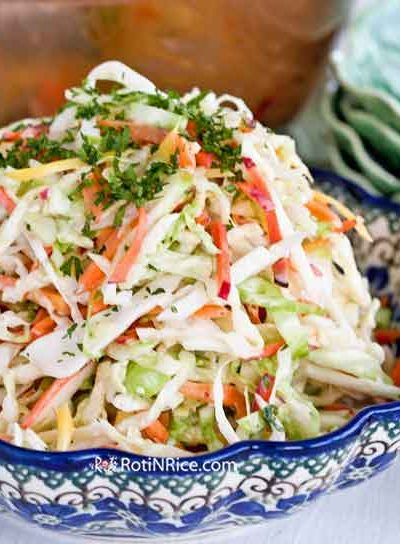 Coleslaw with Carrot Tops - this classic salad is perked up with chopped carrot tops to give it a sweet, earthy, and herbaceous flavor. Very refreshing! | RotiNRice.com #coleslaw #carrottops #carrotgreens