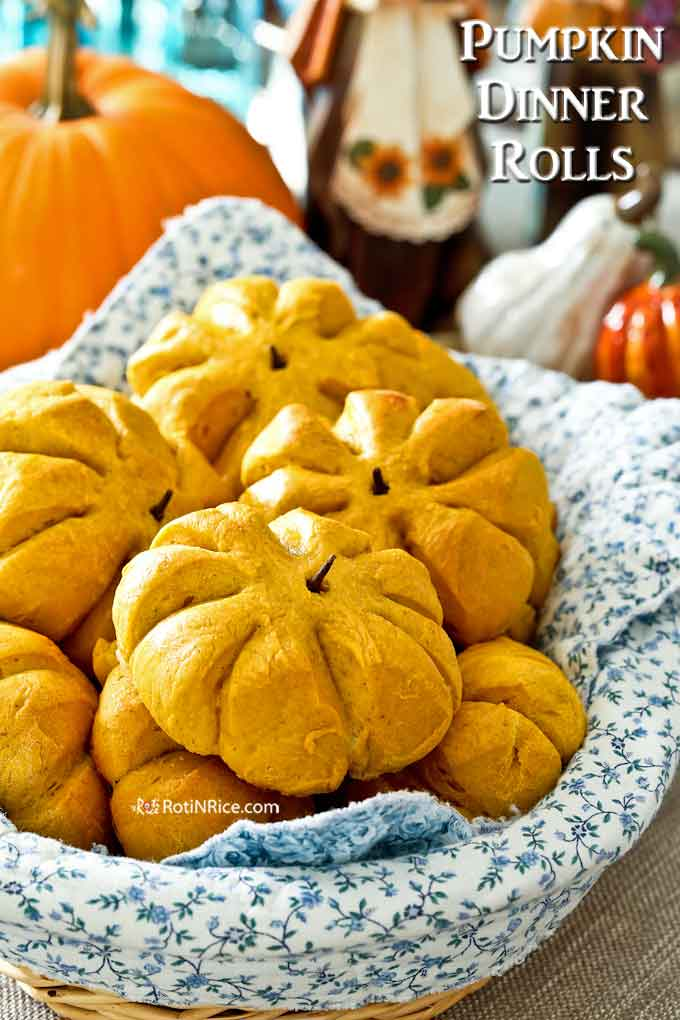 Soft, warm, dinner rolls in a lined basket ready to be served.