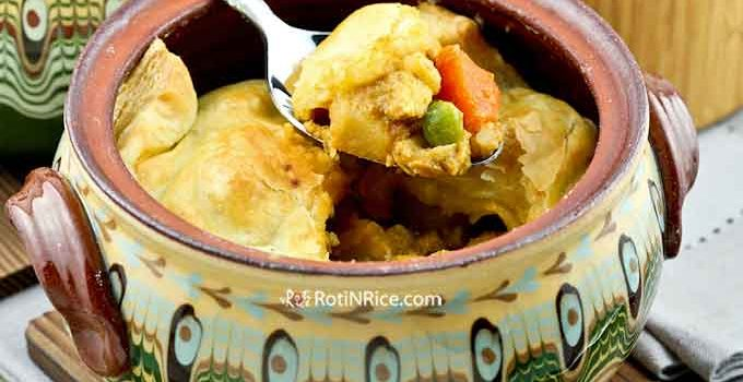 This Chicken Curry Pot Pie is warm, delicious, and full of flavor. The crispy puff pastry combines marvelously with the curry to make a tasty meal. | RotiNRice.com #potpie #chickenpotpie #chickencurry #comfortfood