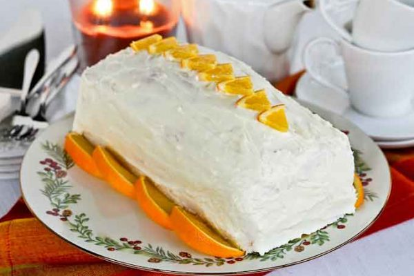 Enjoy the intense orange flavor of this moist and tender Orange Swirl Cream Cheese Pound Cake. The cream cheese frosting makes it even more delicious. | RotiNRice.com #poundcake #creamcheese #oranges #cakerecipes