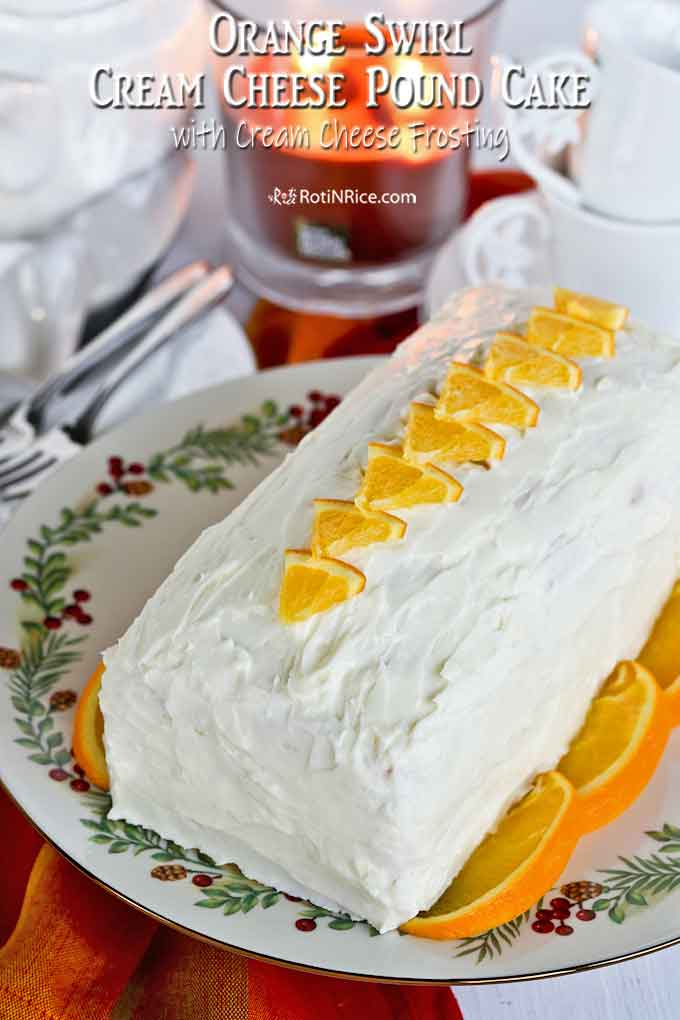 Beautifully frosted and decorated Orange Swirl Cream Cheese Pound Cake.