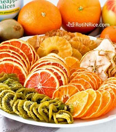 Make your own Dried Fruits in Oven using the dehydrate setting. Just cut the fruits, arrange them on wire racks, and allow the oven to do the rest. | RotiNRice.com #driedfruits #dehydratefruits #healthysnacks