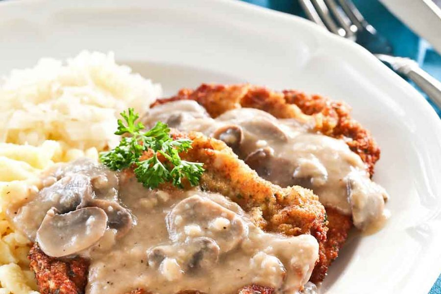 Deliciously crispy Jagerschnitzel drizzled with your choice of creamy mushroom sauce served with spaetzle and sauerkraut.