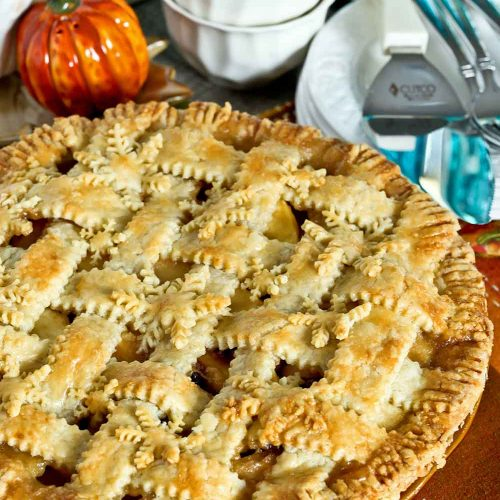 Apple Cranberry Pie with lattice crust and snowflake pastry cutouts.