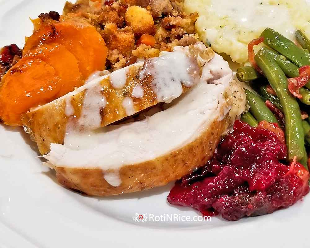 Thanksgiving dinner with Make Ahead Roast Turkey and lots of delicious side dishes.