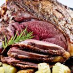 Tender and juicy Roast Leg of Lamb with pink in the center.