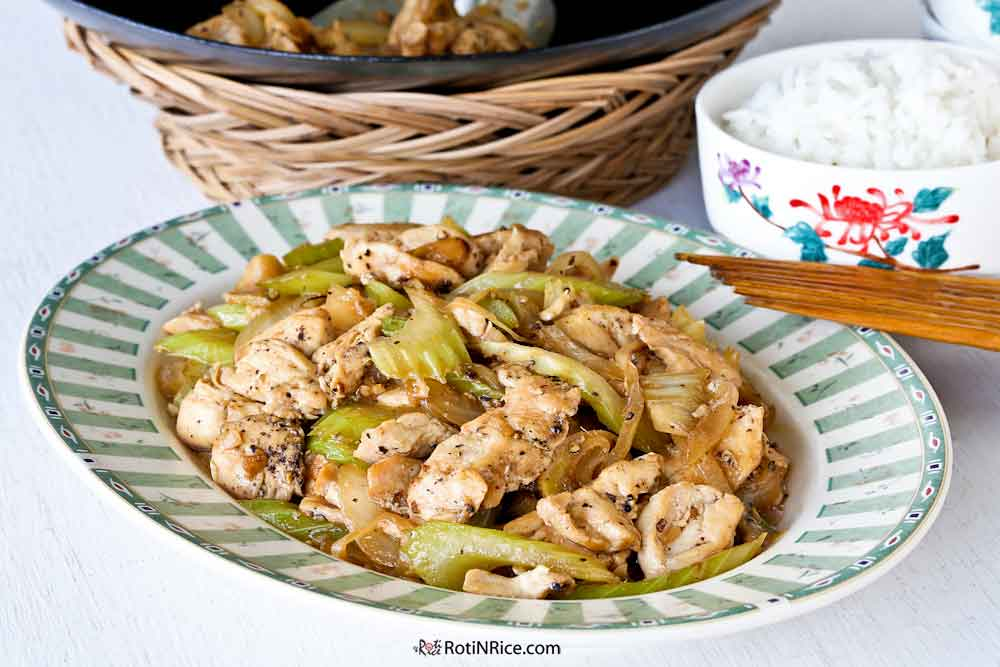 Black Pepper Chicken Stir Fry served with steamed rice.
